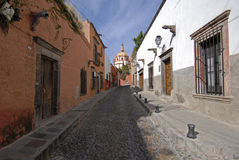 Cobblestone Street in Mexico. Cobblestone street in the classic Spanish colonial mountain mining town of San Miguel de Allende, Mexico Royalty Free Stock Photo