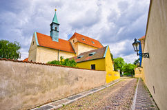 Cobblestone street near Capuchin monastery, Hradcany, Prague, Czech Republic Stock Images