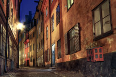 Cobblestone street at night. Royalty Free Stock Image