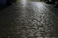 Cobblestone street [night]. Image of paved road in Gdansk Royalty Free Stock Photo