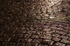 Cobblestone street in the night Royalty Free Stock Image