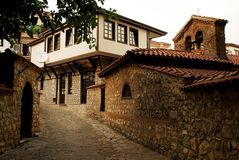 The cobblestone street in Ohrid, Macedonia. The cobblestone alleyway and an old stone church located in the town of Ohrid, Macedonia (FYROM Royalty Free Stock Images