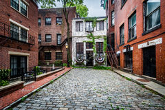 Cobblestone street and old buildings in Beacon Hill, Boston, Mas Stock Photography