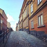 Cobblestone street with old buildings in Stockholm Royalty Free Stock Photography