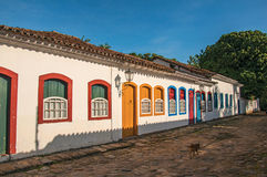 Cobblestone street with old houses under blue sunny sky in Paraty. Royalty Free Stock Images