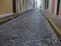 Cobblestone street of Old San Juan, Puerto Rico. Narrow cobblestone streets add to the quaint atmosphere of Old San Juan, Puerto Rico stock image