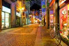 Cobblestone street in old town of Alba, Italy. Stock Photography