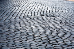 Cobblestone street pavement pattern closeup Royalty Free Stock Image