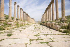 Cobblestone street with Roman columns Stock Photography