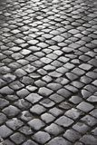 Cobblestone street in Rome, Italy. Royalty Free Stock Photography