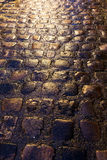 Cobblestone street. Wet cobblestone street at night, ideal for backgrounds and textures Stock Photo