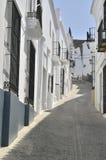 Cobblestone street in white town Royalty Free Stock Photo