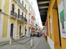 Cobblestone streets and architecture in San Juan, Puerto Rico - March 9, 2017 - Restaurants in Old San Juan. Historic buildings in Old San Juan royalty free stock image