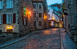 Cobblestone Streets in Old Quebec. Quebec City, Quebec, Canada - Sept. 9, 2015:  Night brings a romantic character to the old stone buildings of historic Quebec Stock Photo