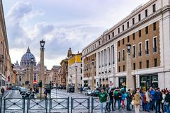 Cobblestone streets of Rome with Saint Peters Basilica in the Vatican City Basilica Papale di San Pietro in background stock photos