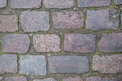 Cobblestone surface. Old cobblestone street surface texture background Stock Image