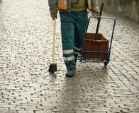 Cobblestone sweeper. In Praque the cobblestones are keep clean by brushing stock photography