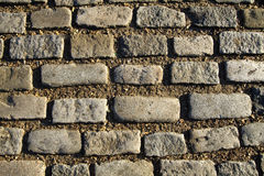Cobblestone texture. Old cobblestone floor as an old fashioned background stock photo