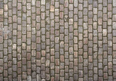 Cobblestone texture. Cobbled road close-up; texture; background Royalty Free Stock Image