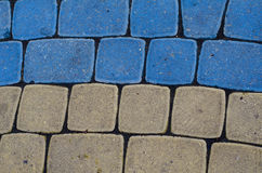 Cobblestone texture, geometry, yellow and blue Royalty Free Stock Photos