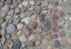 Cobblestone texture. Granite red rock Royalty Free Stock Photos