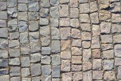 Cobblestone texture. Stone block floor of pavement Stock Image