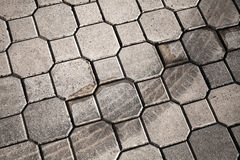 Cobblestone with tire track Royalty Free Stock Photos