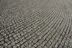 Cobblestone walkway texture. An angled perspective on a gray cobblestone walkway, showing pattern and texture Stock Image