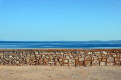 Cobblestone wall against sea and sky Royalty Free Stock Images