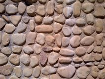 Cobblestone Wall. A wall built with cobblestone royalty free stock photo