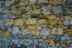 Cobblestone wall Stock Images