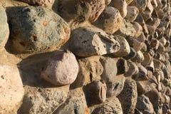 Cobblestone wall texture. Stone pattern. Round cobblestone. Background of stone wall Royalty Free Stock Photo