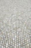 cobblestoned granittrottoar för bakgrund Royaltyfria Foton