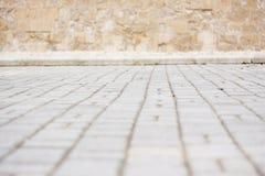 Cobblestoned Straße verwischt Stockbild