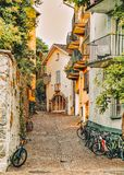 Cobblestoned Street with bicycles at romantic luxury resort in Ascona. Town on Lake Maggiore of Ticino canton in Switzerland. Outdoor expensive family travel in stock photography