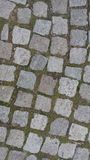 Cobblestoned trottoar för granit Arkivbilder