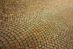 Cobblestones. Detail of a patterned cobbled courtyard stretching away into the distance Stock Photography