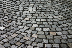 Cobblestones. Cobbled pavement stock images