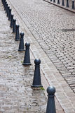 Cobblestones and Bollards in the Rain Royalty Free Stock Photo
