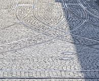 Cobblestones and crossed tramway rails Royalty Free Stock Images