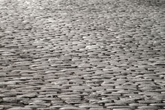 Cobblestones illuminated by moonlight Stock Photography