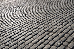 Cobblestones lighted by the sun Royalty Free Stock Photography