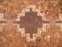 Cobblestones with lnca Cross Inlay. A cobblestone inlay of the Inca cross design found on a street in ancient Cusco, Peru Royalty Free Stock Image