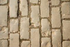 Cobblestones na estrada velha Imagens de Stock Royalty Free
