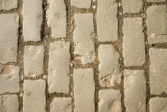 Cobblestones on old road. Weathered texture and pattern of cobbled road Royalty Free Stock Images