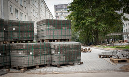 Cobblestones on pallets. Road repairs of apartment houses in the Stock Photo