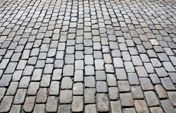 Granite cobblestone street pavement in perspective Royalty Free Stock Images