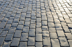 Cobblestones pavement with polished surface Stock Image