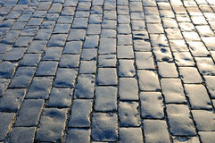 Cobblestones pavement with polished surface Royalty Free Stock Images