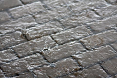 Cobblestones in the rain Royalty Free Stock Image